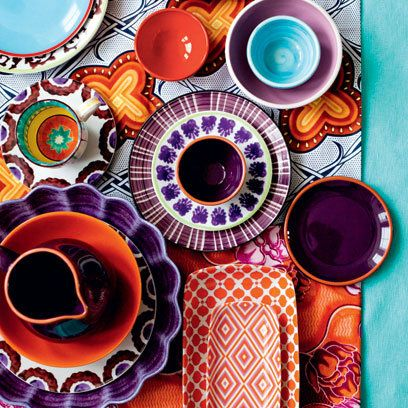 Brightly colored mismatched dishes.