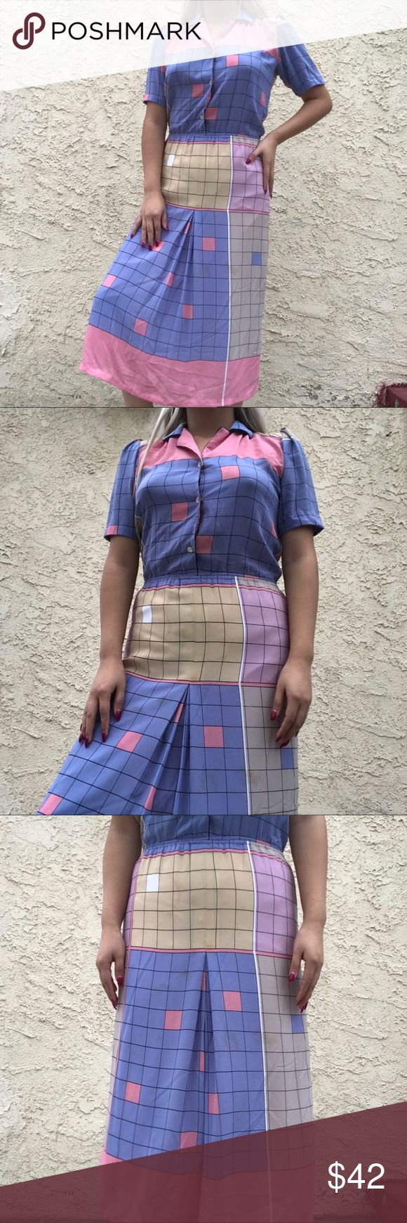 """Vintage grid pastel dress How is this dress even real?! 😩💗 gorgeous vintage pastel colored grid dress 😍 no label on it. Would best fit small or medium The dress is a bit dirty as you can see in the 3rd picture of the skirt area but it isn't very noticeable and can easily be dry cleaned! Length of dress is 46"""" Waist is 26"""" and can stretch to fit a 29"""" conformably. Shirt part is 16"""" long Skirt part is 29"""" long Dresses Midi"""