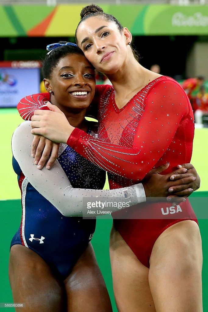 Simone Biles (L) of the United States waits for the score after competing on the…