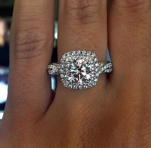 Maybe not all the glitz, but I do really love the idea of a larger engagement ring. I don't care for high settings.