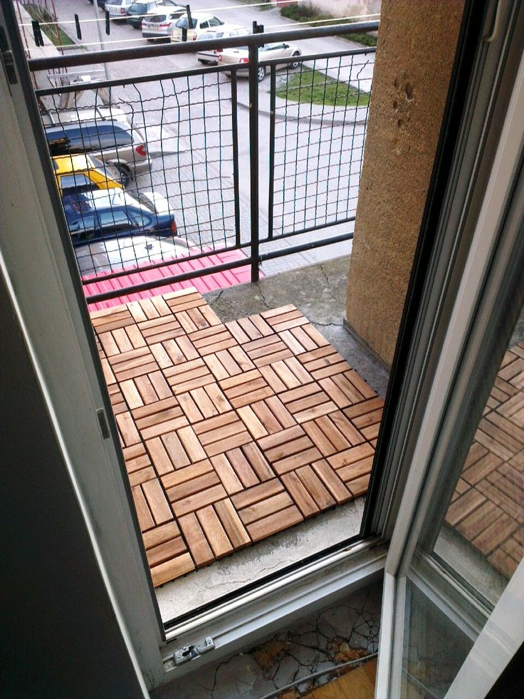Wooden floor tiling for an apartment balcony. Great idea to customize a rental! #rental #apartments #DIY