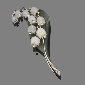 A carved quartz, serpentine and diamond lily-of-the-valley brooch; the lily of the valley signifies the return of happiness in the language of flowers. (Bonhams)