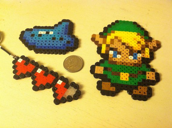 Legend of Zelda 8 Bit Link Ocarina Heart Container by Unraveled Adornments, $4