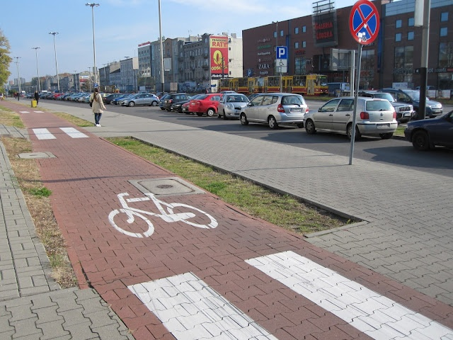 Poland is hardly a model country when it comes to infrastructure, to put it mildly, but the wide boulevards can fairly easily be accommodated with lanes for bikes and of course there are trams. Aleja Piłsudskiego, Łódź