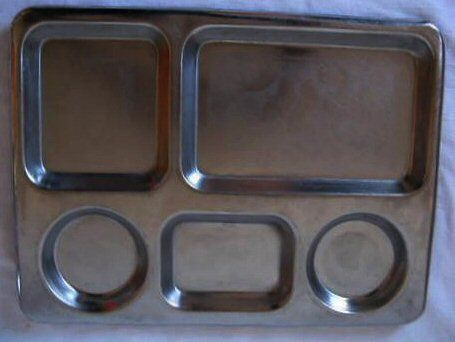 Varkpan (Afr): A stainless steel tray with divisions where your food gets dished into.