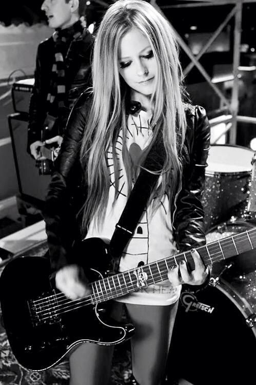 I remember growing up in my tween years listening to Avril Lavigne---Still love her music now!