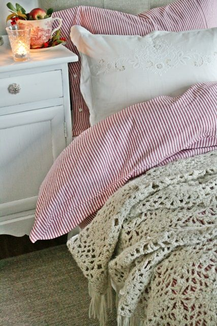 Pretty bedding ... love the red and white ticking with the Battenburg