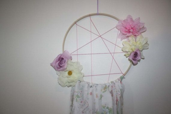This dream catcher is one of a kind and gorgeous! It measures 12 inches across the ring. 41 inches from the top of the ring to the bottom of the