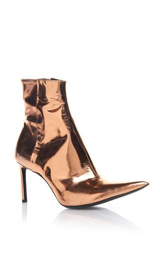 These **Haider Ackermann** boots are rendered in leather and feature a pointed toe and monochrome colorway.