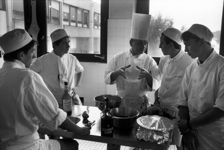 Magnum Photos Richard Kalvar FRANCE. Ile-de-France region. Yvelines department. Town of Conflans St Honorine. 1992. Cooking class at a vocational high school