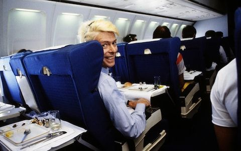 Bowie, awaiting an airline meal, flying over Australia.