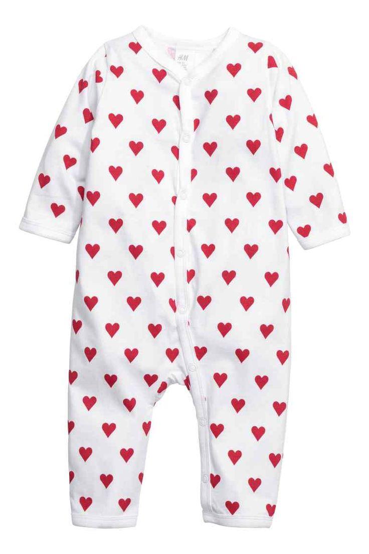 Pyjama en jersey: CONSCIOUS. Pyjama à motif imprimé en jersey souple de coton bio. Modèle avec boutons-pression devant et le long d'une jambe.