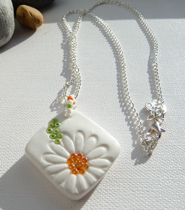I love the combination of polymer clay and tiny beads in this pretty daisy pendant £10.00 by Georgia P Handmade Jewellery on Folksy