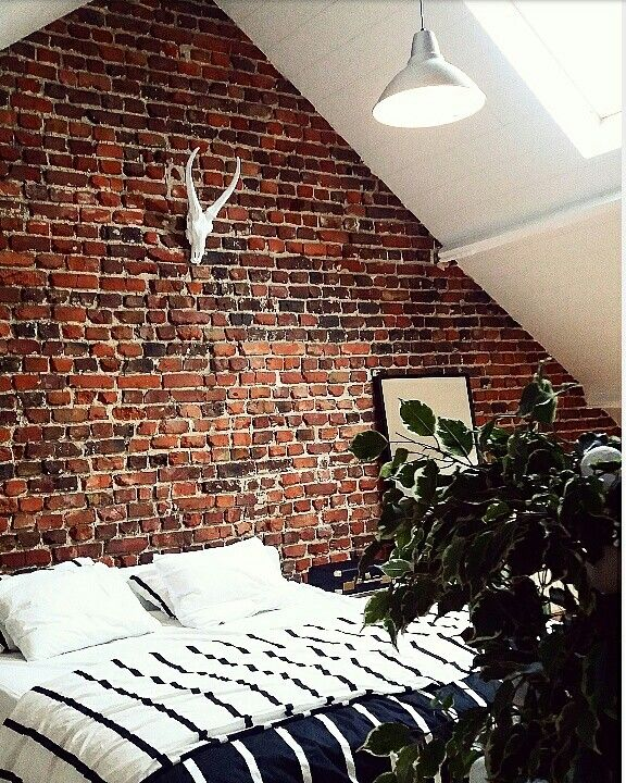exposed brick in the bedroom
