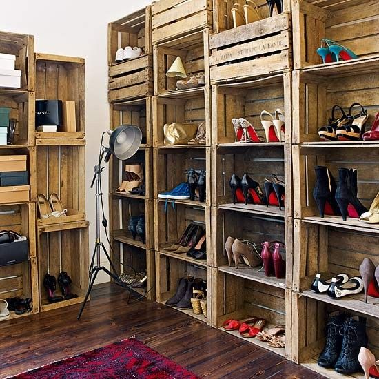 Vintage apple crates have been turned into a shoe shelving system in the dressing room