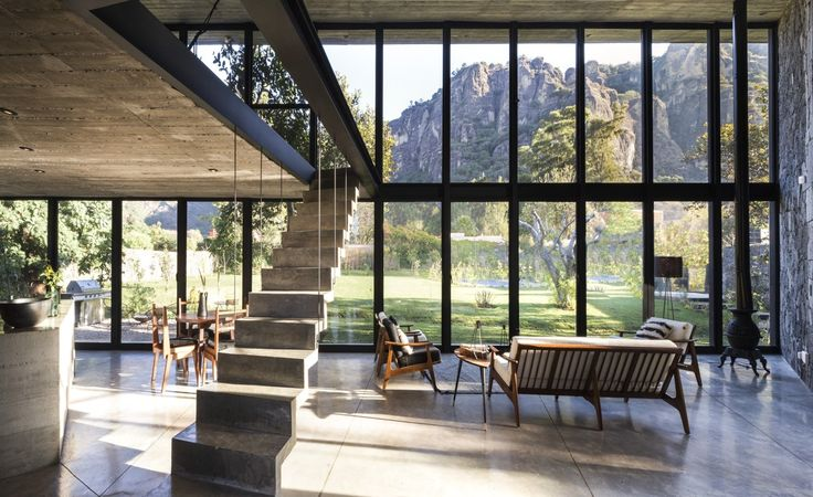 The large open living area with full-height glazing makes the most of the views