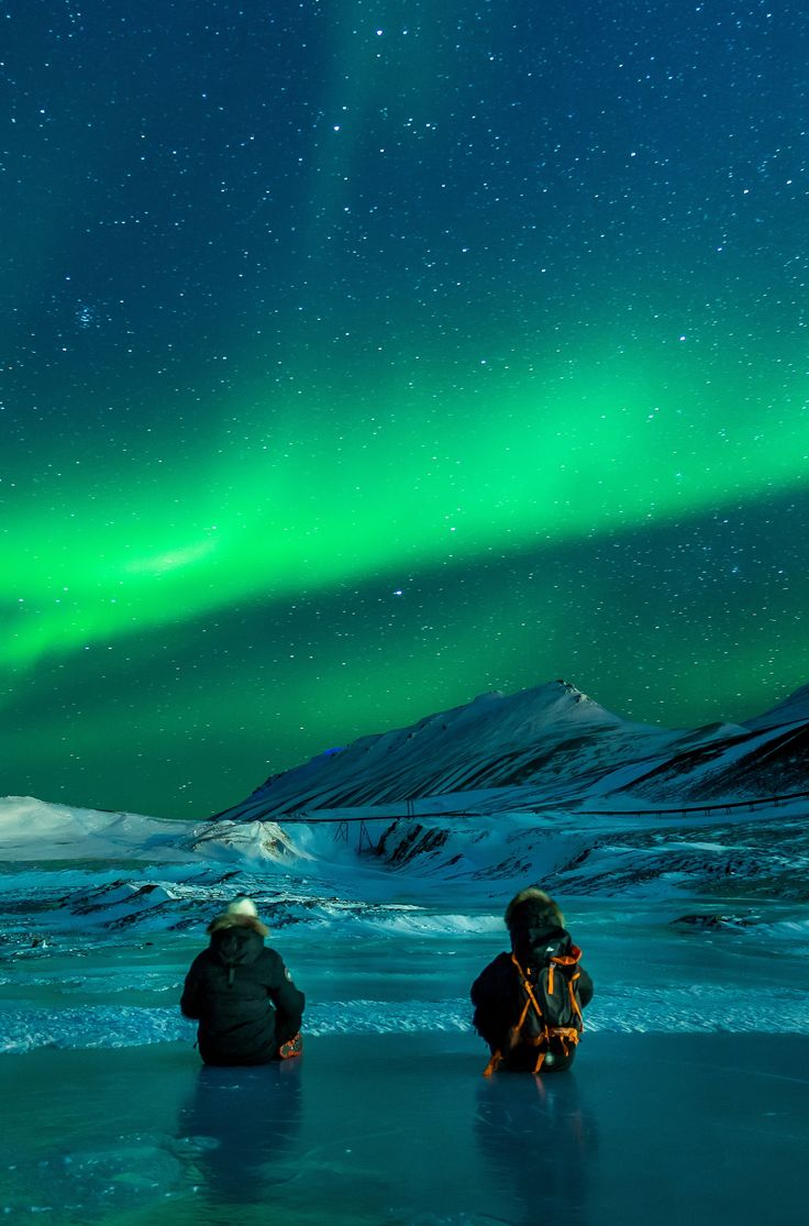 The Northern Lights in Svalbard, Norway. Winter here sees 24 hour darkness. Click pin through to post for more photos.