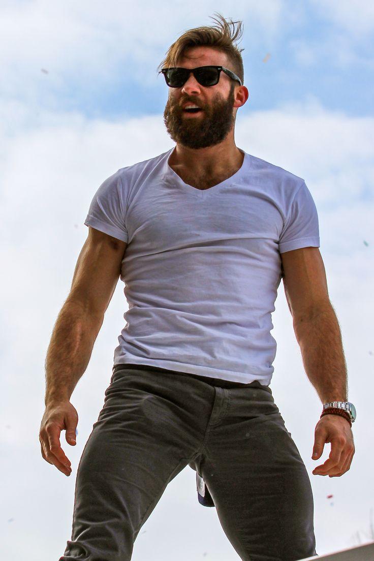 Julian Edelman - Hot Macho Guy look - cargo pants, T-shirt, shades and the awesome beard.