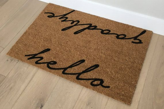 Gifts for Girlfriend - Gifts for Mom - Gifts for Aunts - Hello Goodbye Doormat - Unique Door Mat - Handmade Gifts - Client Gifts  PUPPY NOT INCLUDED ;)  This mat makes a wonderful gift for mothers, sisters, aunts and girlfriends! It is beautifully designed and incredibly unique. Our Hello/Goodbye doormat is modern and minimalistic yet also a classic piece of home decor!  Made out of natural (renewable) coir fibers, all our mats are mildew and mold resistant and have a sturdy latex backin...