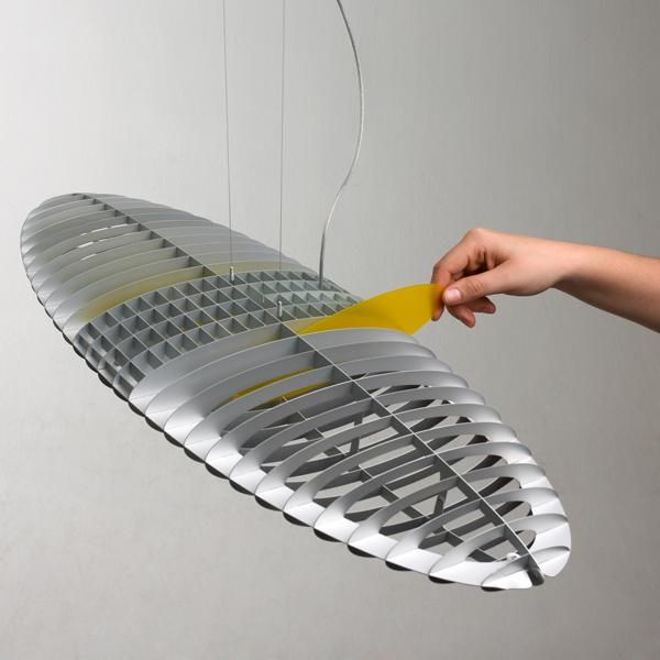 """Five pairs of polycarbonate interchangeable filters determine the varying colours of its lamellar body. In fact #Titania #suspensionlampcan be coloured as desired, by a simple movement of the hand to slot the different filters in and out and to give the lamp a """"dematerialised"""" colour - while always maintaining an emission of white light! http://www.luceplan.com/Prodotti/1/2/96/Titania"""