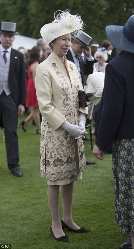 The Princess Royal talks to guests during a garden party at Buckingham Palace in London.