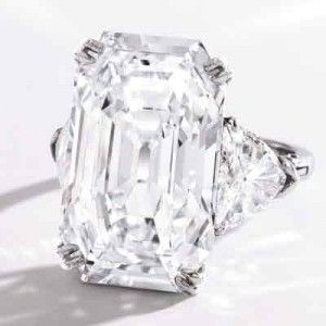 One of the many important coloress diamond rings being shown at Sotheby's New York is a 19.51- carat Harry Winston diamond ring. This ring, chosen to lead Sotheby's Important Jewels auction on September 24, features an E color, VVS2 clarity, 19.51-carat emerald-cut diamond flanked by two triangle-shaped diamonds weighing 2.92 carats. It is expected to sell for between $1.2 and $1.8 million. (Update: final sale price was $2,105,000)