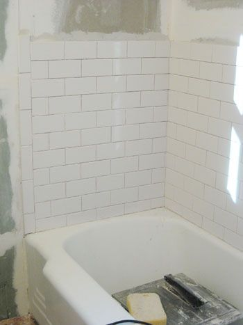 Here's an example of a basic subway tile design.  It even looks like the exact same tub.