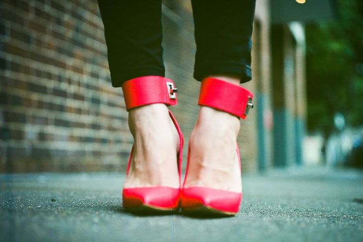Close-up of red high heels