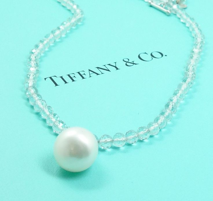 This is a superb estate found vintage Tiffany & Company pendant necklace dating to the 1980s/90s. The single strand necklace is strung with 93 natural aquamarine faceted beads. The beads give way to an eye-catching South Sea pearl pendant at the center. The claps and pendant mountings are rendered in fine 18k white gold. The necklace is accompanied by the original folded holder and the iconically colored Tiffany box.      Condition: In overall excellent condition consistent with age ...