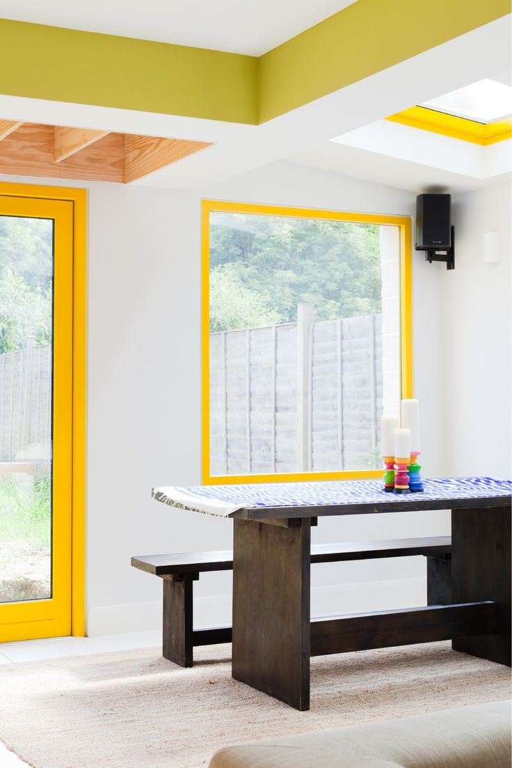 open plan dining space, ply roof, yellow framed windows, yellow framed doors, green downstand