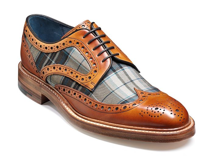 A traditional wingtip derby with a unique twist. This Cedar Calf/ Check Fabric combination is a distinctive addition, Stormwelted on a 10mm Leather Sole.