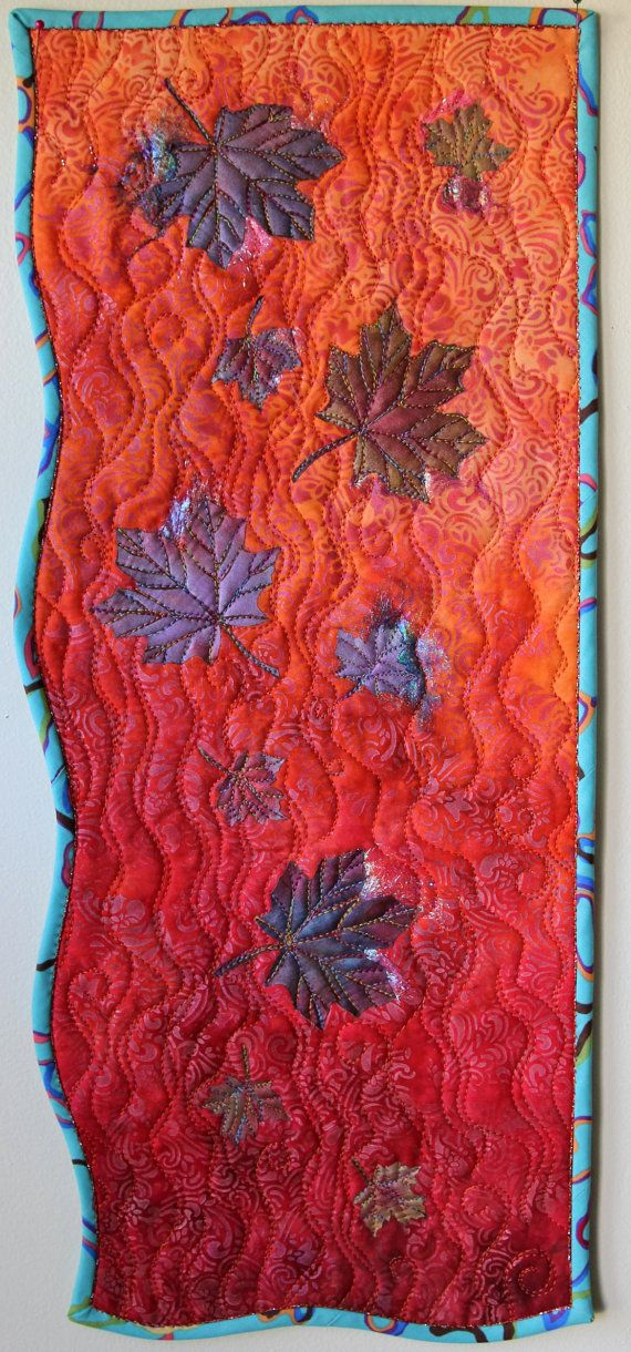 An original design from my studio. This wall hanging was inspired by the color story of a hand-dyed fabric in bright orange, burnt orange and rusty