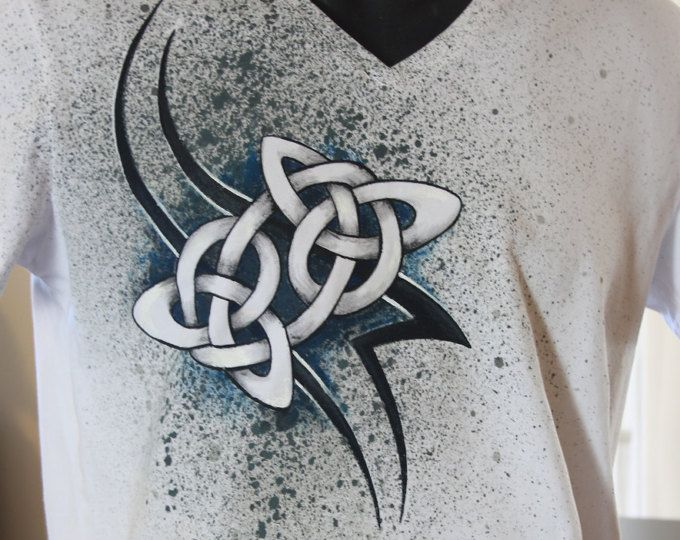 Browse unique items from NotYourUsualTee on Etsy, a global marketplace of handmade, vintage and creative goods. | Hand painted men's t shirt, featuring a Celtic knot on a splatter background. Non-toxic, water based, permanent fabric colors.