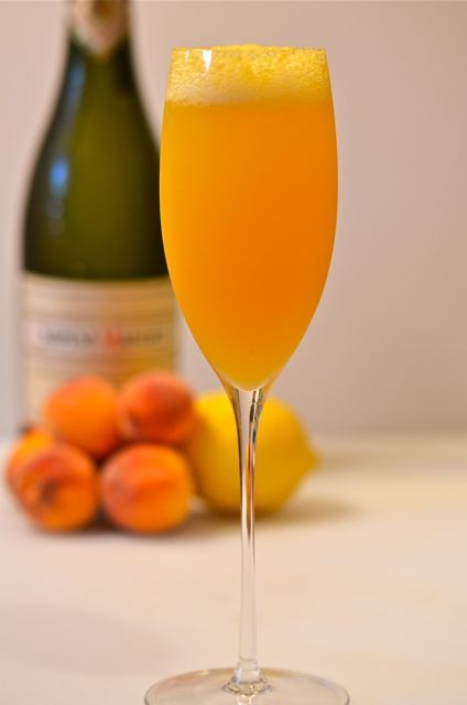 Bellini: 2 oz. fresh peach puree, 4 oz. Prosecco.  Muddle peaches and strain to make puree.  Add puree and ice to a shaker to chill them pour into flute and top with prosecco.