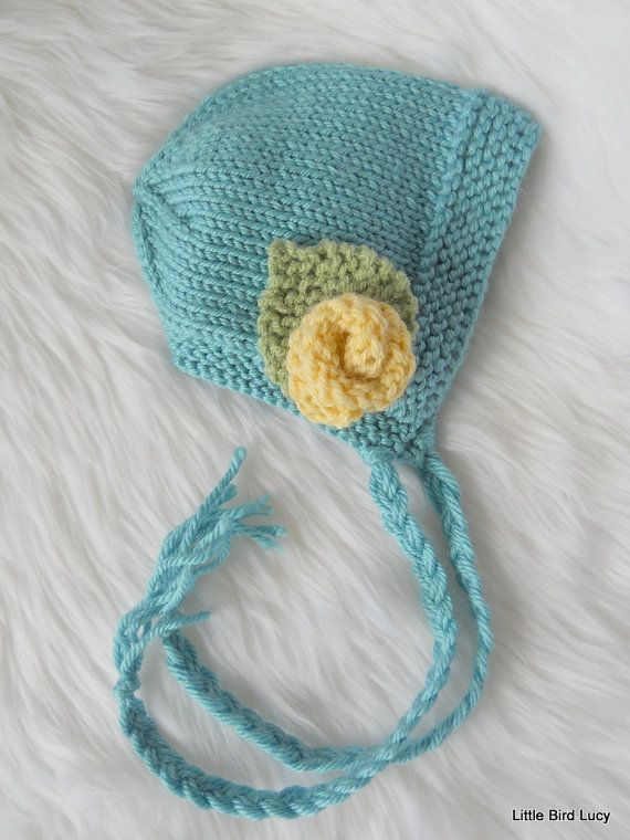 Knit Baby Hat,  Bonnet / Helmet, Knitted Newborn Infant Photo Prop, Removable Flower, Choose from 11 Hat & Flower Colors, Newborn, 0-3 Mo. $25.99, via Etsy.