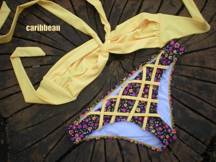 VESTIDOS DE BANO CARIBBEAN  Bikiny con top strapless de anudar al cuello, detalles en el panty tipo canasto.