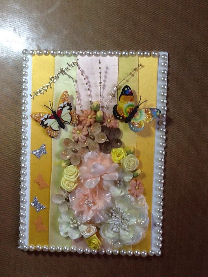 Background is satin ribbons,butterflies are fridge magnets pearls from my stash, flowers from dusty attic,Prima and Bali,beaded sprays from Prima