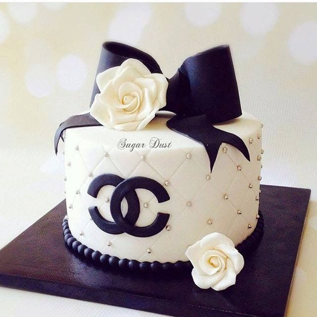 White quilted Chanel cake with black bow