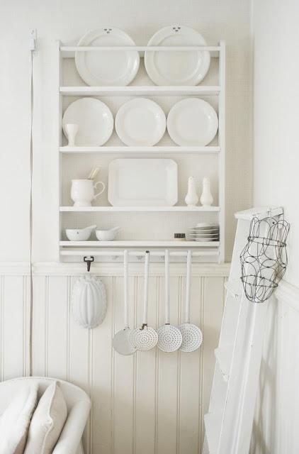 White wall white plates