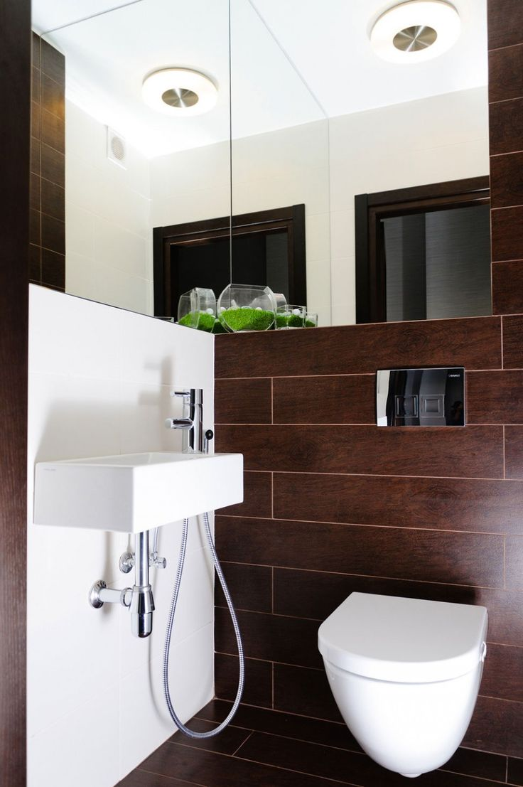 Tiny Modern Apartment In Odessa Bathroom Interior Enlarged By The Existence Of Frameless Mirrors Installed On Upper Wall