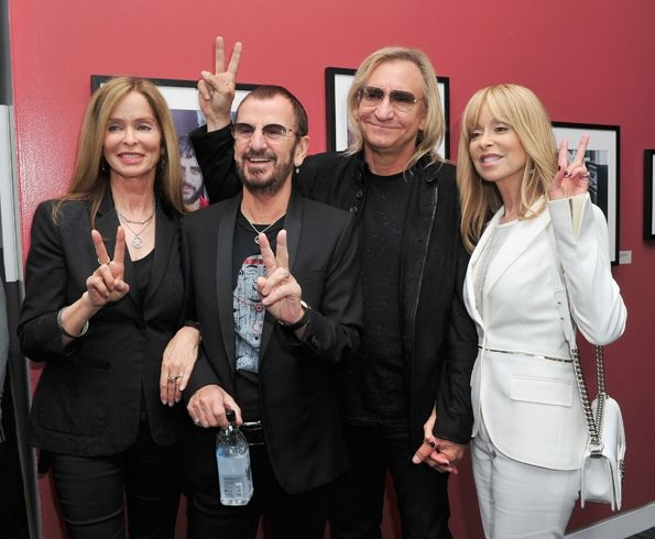 "Barbara Bach, Ringo Starr, Joe Walsh and Marjorie Bach make peace signs for the camera at the ""Ringo: Peace & Love"" exhibit VIP launch event at The GRAMMY Museum in Los Angeles."