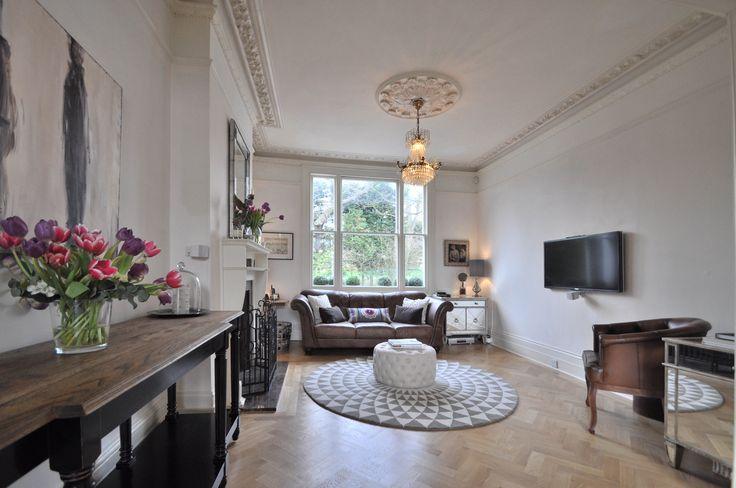 Living room, circular rug from Niki Jones and circular small ottoman/pouffe