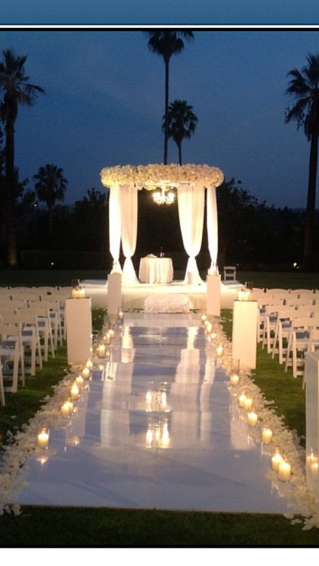Outdoor night wedding aisle with gorgeous lighting