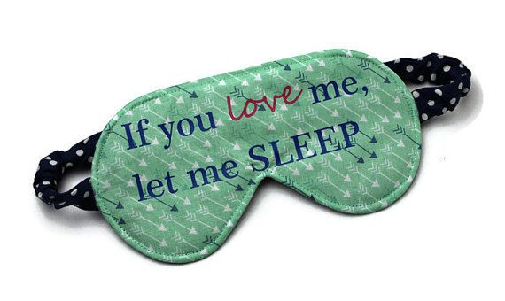 Reversible sleep mask with a small arrow print on mint green on one side and a navy blue and white polka dot print on the other. Has If you love me, let me SLEEP printed in high quality vinyl on the arrow side.  There is a layer of soft polar fleece in the middle to help block out light.  This mask is sized to fit an average adult female. The elastic measures 13.5 in length. The mask itself measures 7.5 across by 3.75 tall.  Machine wash and dry. The side without the vinyl can be ironed. Do…