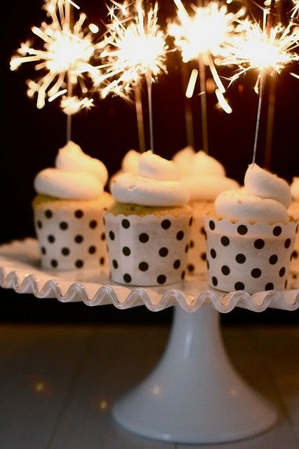 Add sparklers to your cupcakes for a festive dessert!
