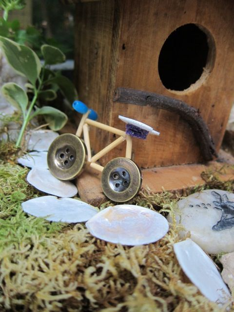 MomArtScience: Stop and look for fairies. I love the bike made out of buttons & toothepicks!