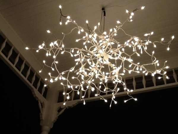 ❥ Umbrella frame without the cloth, spray painted white, then draped with a long line of little white Christmas lights, and hung out on the porch, charming!