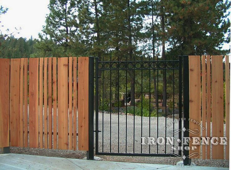 A Custom Style Iron Walk Gate With Rings And Capped