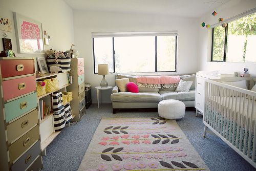 I pretty much think this is an adorable nursery for a baby girl...too bad it probably has a price tag not in my budget :(