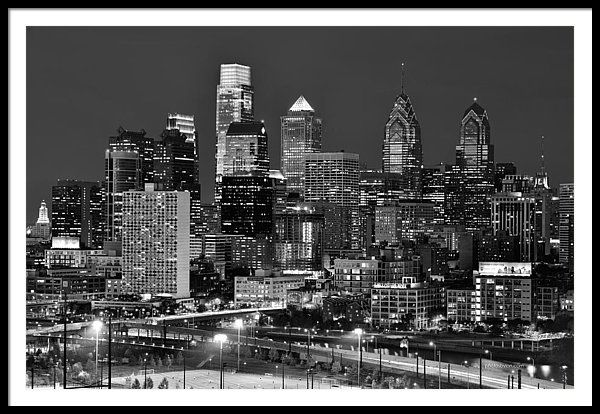 Philadelphia Skyline At Dusk Framed Print featuring the photograph Philadelphia Skyline At Night Black And White Bw by Jon Holiday